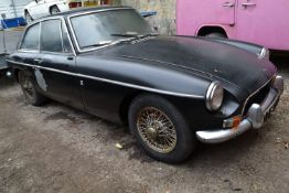 A 1969 MGB GT Registration number NNE 976H Black, originally red Wire wheels No documents or keys