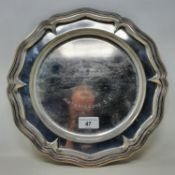 A silver coloured metal salver, inscribed CONCOURS INTERNATIONAL DAY SIX JUR organise pay L'UNION