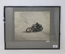 A Motor Cycle monochrome photograph, of a Norton at Brooklands, 23.5 x 29 cm Provenance: Being