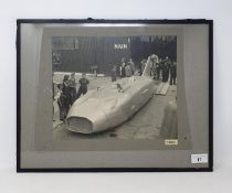 An Autocar monochrome photograph, Thunderbolt land speed record car driven by George Eyston, 24 x 29