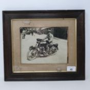 A monochrome photograph, Eric Williams on an AJS (DA 1244), 16 x 20.5 cm Provenance: Being sold