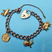 A 9ct rose gold bracelet with four yellow metal charms, a pig, a rabbit, a rose and a cow, 14 g (all
