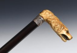A 19th century walking stick, with a carved ivory handle in the form of a snarling dog, on an