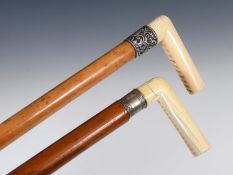 An early 20th century walking stick, with a carved ivory handle and a silver mount, on a hardwood
