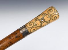 A late 17th/early 18th century walking stick, with a carved ivory pique decorated handle and a