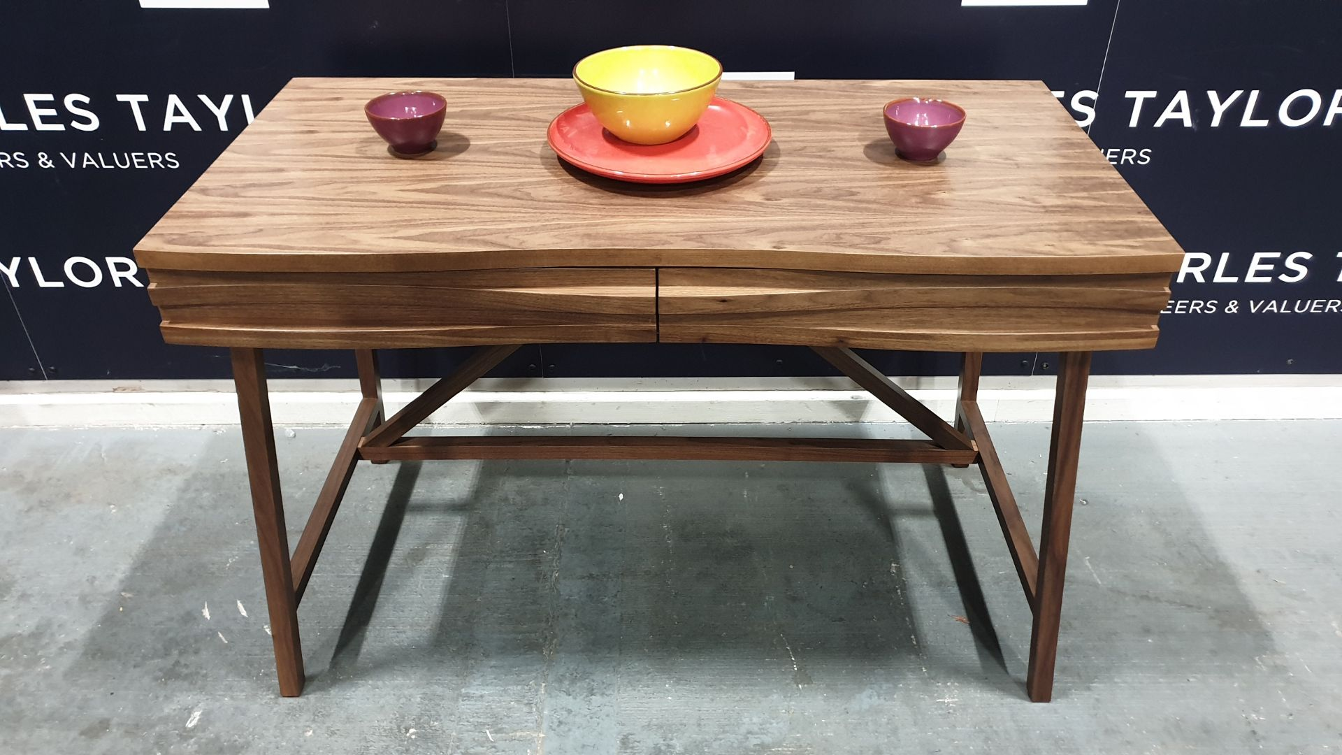Lot 1083 - BRAND NEW CONTENT BY TERENCE CONRAN WOODEN 2 DRAWER WAVE DESK IN WALNUT. - 60 X 120 X 78CM £795.00