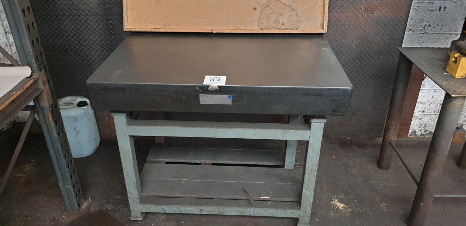 "Lot 82 - 48"" x 36"" granite surface table on steel stand"