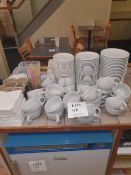 Large quantity of cups and saucers
