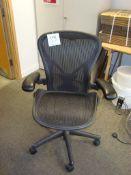 A Herman Miller Aeron swivel office elbow chair