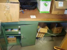 A steel framed work bench with cupboard under