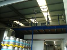 A steel framed mezzanine floor structure, approximately 13x7m, with two insulated cold room