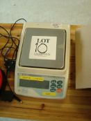 An AND GF-2000EC set of bench sensitive digital weighing scales Serial number T0351194