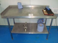 A stainless steel catering preparation table