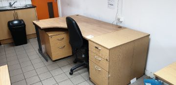 Curved desk with three drawers and two drawer desk pedestals and swivel chair