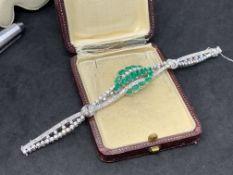 Exquisite 4.85ct Emerald and diamond bracelet set in 18 carat white gold G colour diamonds