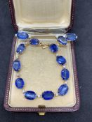 10 carat gold bracelet ring and earring set with blue stones and diamonds
