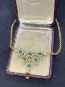 18 carat gold necklace set with emeralds and baguette diamonds weighs 32 g