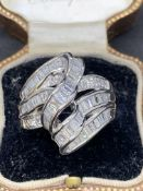 Platinum Ring set with 2.00 cts baguette diamonds Approximately 14 g
