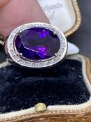 18 carat gold ring set with approximately 6 carat amethyst with diamonds approximately 9 g