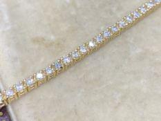 18 carat yellow gold diamond tennis bracelet approximately 2.24 carats G colour VS clarity