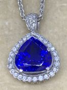 18 carat gold 7ct Tanzanite and one carat diamond heart pendant and chain Approximately 19.4 g