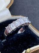 18 carat white gold Emerald shaped diamond set ring approximately 1.8 carats of diamonds