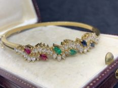 18 carat gold bangle set with rubies emeralds sapphire and diamonds H/I colour VS/SI clarity