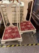 Pair of old dining chairs been painted upholstered seats with elephant pattern
