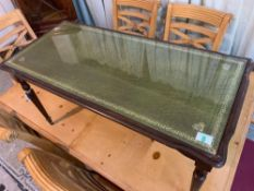 Small occasional table with leather insert with a glass on top