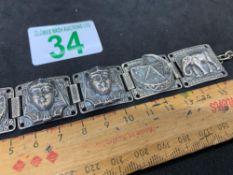 White metal coloured bracelet with Egyptian figures and elephants star moon hallmark