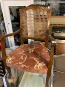 Upholstered Carver chair back a small hole in wickerwork