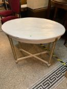 White and gold painted oval table