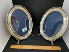 Pair of matching oval frames tested as silver