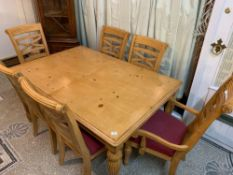 Table and six chairs consisting of two carver chairs and four matching chairs with upholstered seats