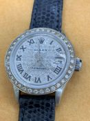 Ladies stainless steel Rolex set with aftermarket diamond dial and diamond bezel 26mm