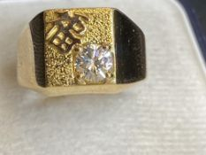 YELLOW METAL CHINESE WRITING WITH 0.60ct G/VS DIAMOND SET RING - TESTED AS 18ct GOLD - 9 GRAMS