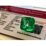 GREEN STONE WITH CARD MARKED EMERALD