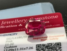 PINK STONE WITH CARD MARKED SAPPHIRE
