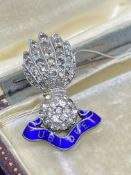 UBIQUE BROOCH SET WITH WHITE STONES