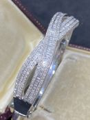 18ct WHITE GOLD 7.00ct DIAMOND X-OVER HINGED BANGLE - 33.48 GRAMS