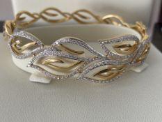 18ct GOLD DIAMOND SET PATTERNED HINGED BANGLE