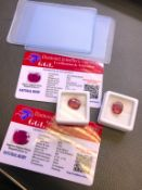 2x RED STONES WITH CARD MARKED RUBY