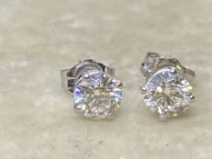 1.00ct DIAMOND SOLITAIRE EARRINGS SET IN 14ct WHITE GOLD