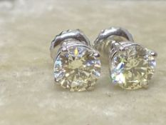 1.54ct DIAMOND SOLITAIRE EARRINGS SET IN 14ct WHITE GOLD