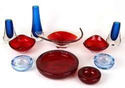 A quantity of Whitefriars art glass bowls and vases to include a Geoffrey Baxter cased bowl with
