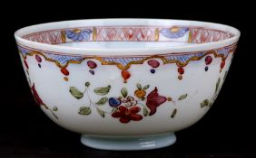An 18th century enamelled milk glass slop bowl with Chinese style decoration, possibly Bristol,
