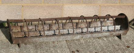 A cast iron feeder / planter, 125cms (49ins) wide.