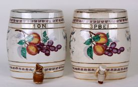 Two pottery spirit barrels, Lemon and Raspberry, each decorated with fruit, each 21cms (8.25ins)