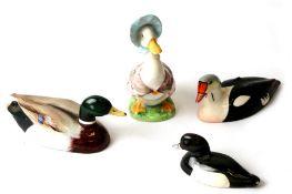 Three Beswick Approved by Peter Scott birds comprising a Kin Eider, a mallard (beak glued), a tufted