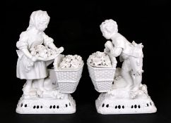 A pair of Meissen style blanc de chine figural groups in the form of a young boy and girl with